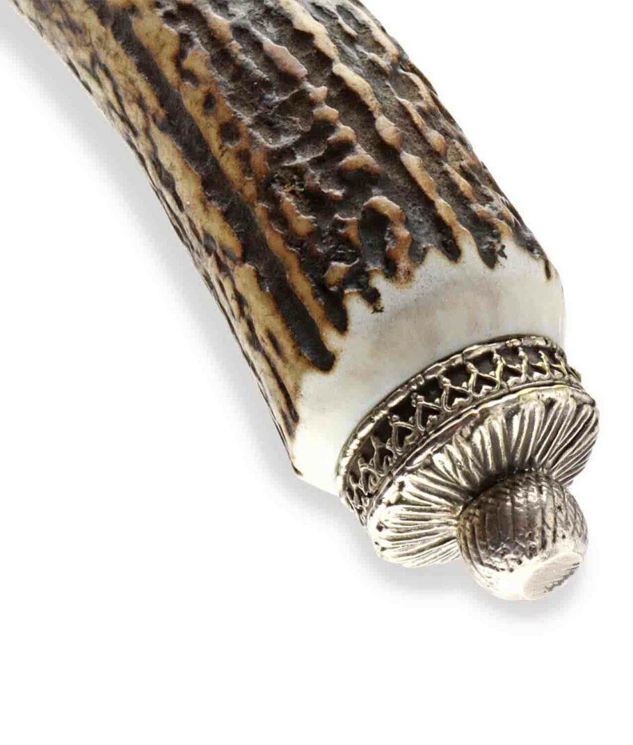 Krone eines Hartkopf Trachtenmessers mit Schnupftabakdose.