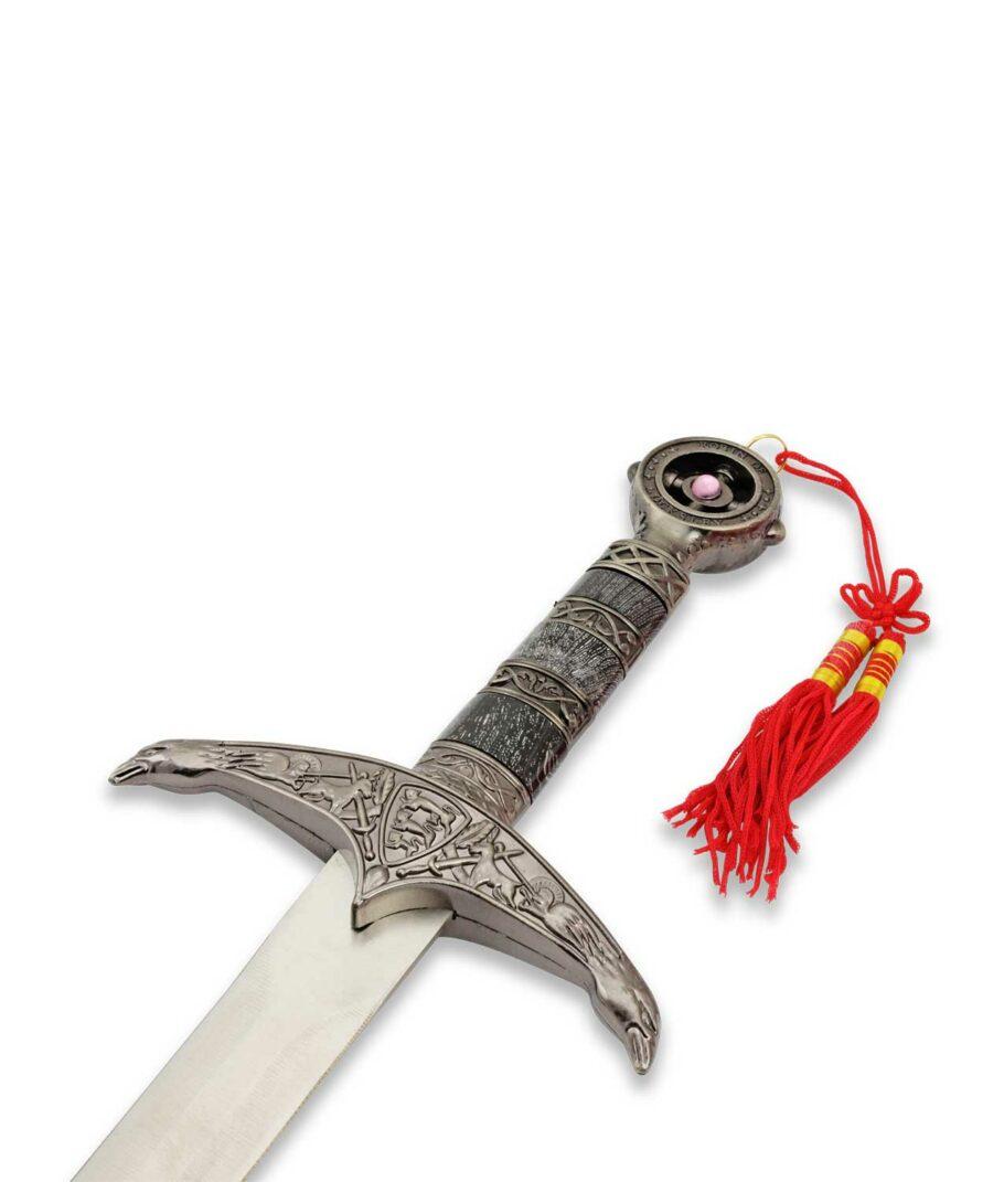 Der verzierte Griff des schwarzen Robin Hood Waffenkammer Dolchs